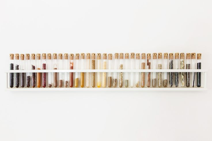 Test tubes found in the fleamarket become a functional spice rack and a work of art for our kitchen wall