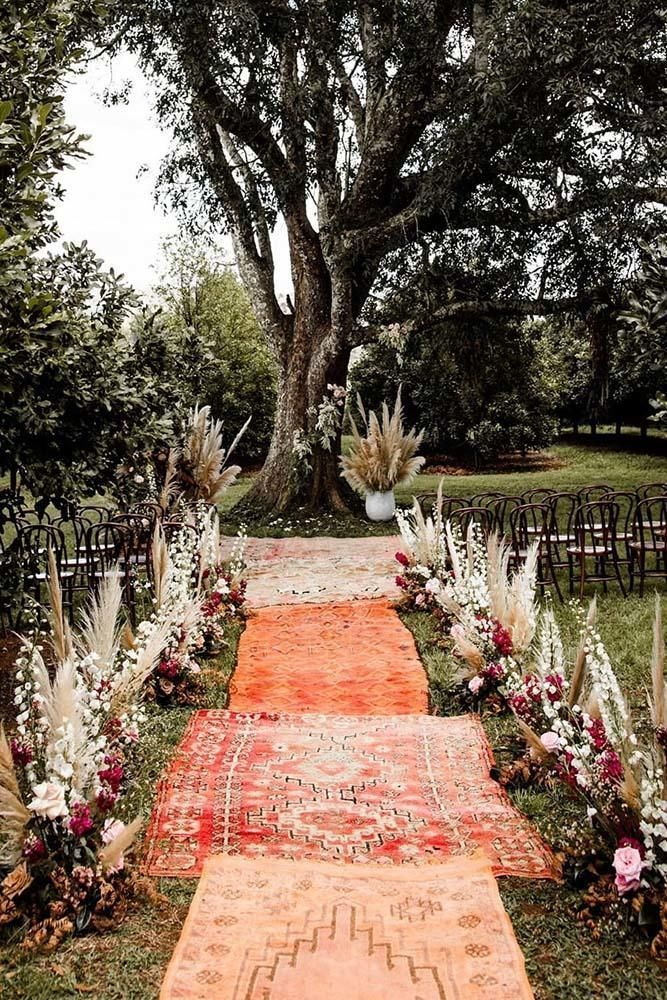 7 Traditional And Modern Wedding Ceremony Ideas To Make Your Wedding Day Memorable ❤ wedding ceremony ideas outdoor woodland ceremony with pampas grass flowers and carpets in the aisle elisabettalillyred #weddingforward #wedding #bride #weddingdecor #weddingceremonyideas #bohowedding #weddingceremonyideas