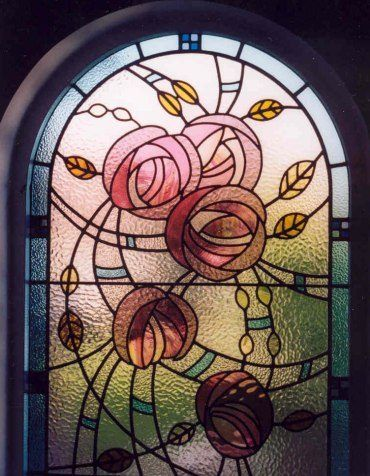 Stained glass window designed by L. Butcher, and manufactured by R. Clunas and L. Butcher in 1999, it was inspired by Charles Rennie Mackintosh's famous rose design