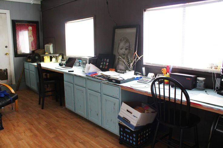 My brother's DIY office from old cabinets and an IKEA desk top.  I am so doing this.