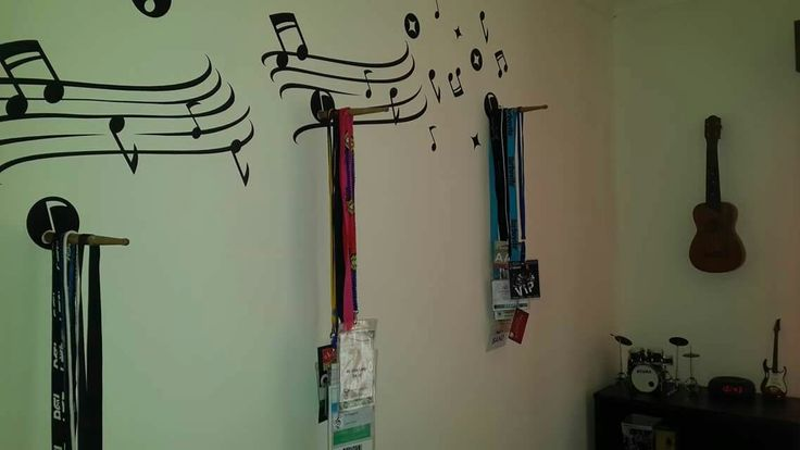 Use broken drum sticks to glue onto wall to hang backstage passes
