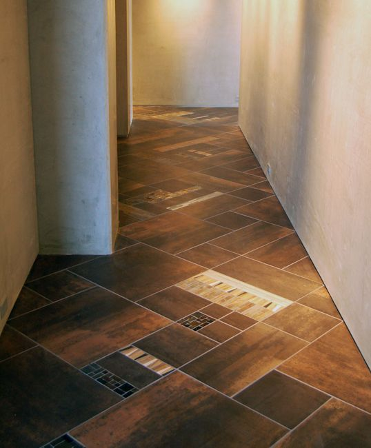 This is a great example of how tile layout can make all the difference. What could have been an easily-forgotten hallway space is transformed into a one-of-a-kind tiled gem.
