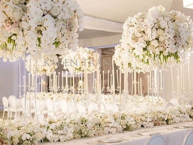 Swooning over this all white affair!! Those floral centerpieces took my breath away!