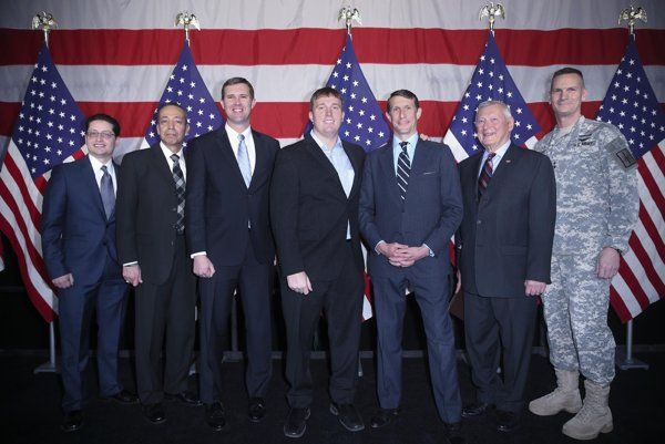 From left, Evan Guzman, Verizon, John Ramirez, University of Phoenix School of Advanced Studies, Eric Eversole, Hiring Our Heroes, Sgt. Dakota Meyer, Medal of Honor recipient, Ben Lamm, Army veteran and VP of Servicemember Affairs for Capital One, Don Esmond, Toyota USA, Major General Patrick Murphy, 52nd Adjutant General of New York State, at the Hiring Our Heroes job fair, at the 69th Regiment Armory, Thursday, March 27, 2014, in New York