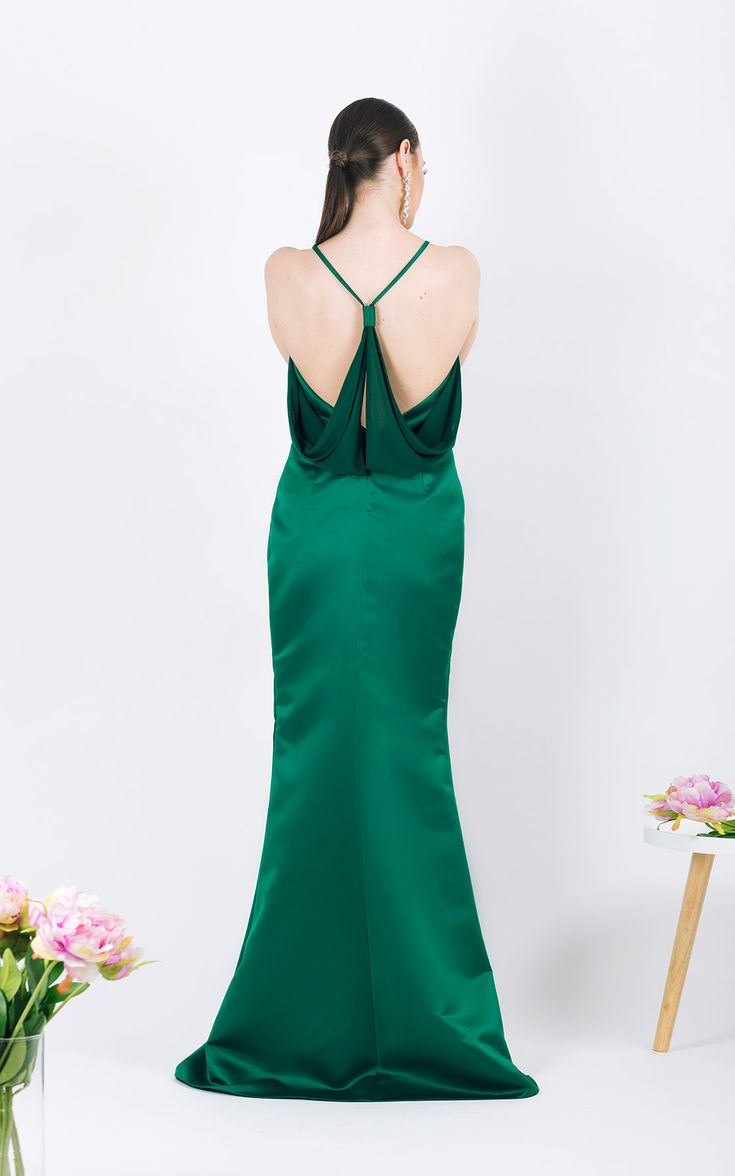 Draped dress with side slit      Fastening zipper at the back  ...