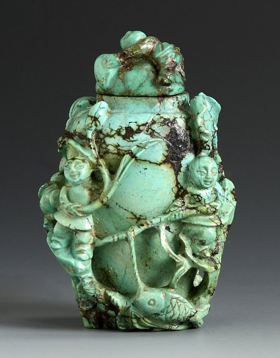 High relief carved turquoise snuff bottle sgn