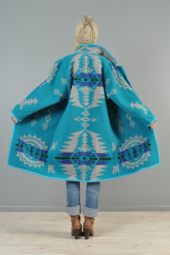 Pendleton fabric or blanket coat, some people use the yardage and others a blanket...less expensive made from the yardage, same quality.