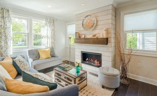 glass vase with twigs    A Gutted Connecticut Home Gets A Fantastic Facelift   Apartment Therapy