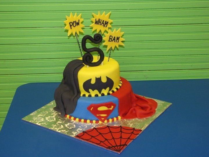 Super hero cake for my nephew's bday. He designed the cake, believe it or not...not bad for 5 yrs old! All went well with the cake other than securing the number 5 on the cake. I used lollipop sticks which you can see, much to my dismay. However, if I pushed them into the cake any more than I did, the 5 would have broken all to pieces. So, if anyone has pointers on this, PLEASE share. TFL!