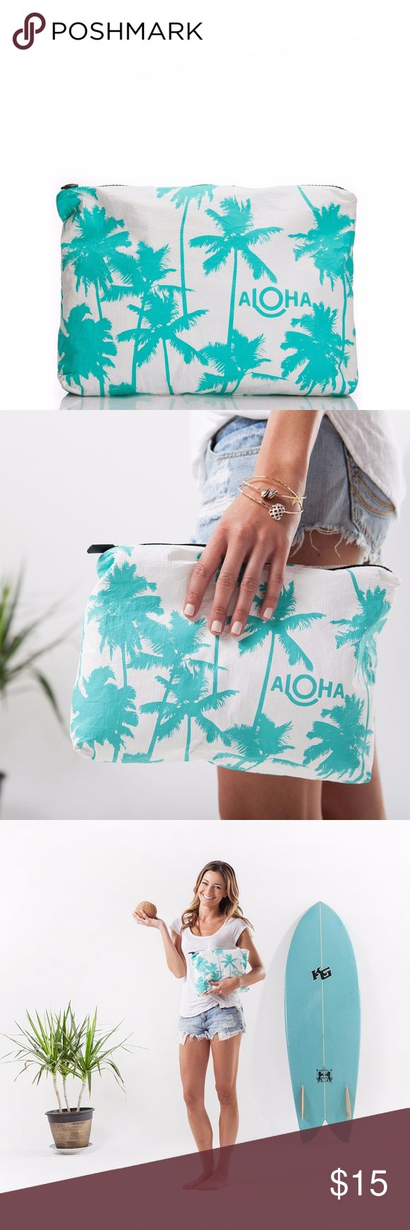 "Aloha Mid-Size Coco Palms Pouch Clutch Ocean Print Take a little Kauai with you on your next adventure! This print was inspired by Kauai's coco palms and the famous Coco Palms Resort.   This pouch is perfect to use as a beach clutch.  Stow your sunscreen, sarong, and bikini, or pack toiletries for your next trip! This pouch is made from 100% coated Tyvek, so it is splash proof.   Mid-size pouch measures:  11.5"" across x 2"" wide x 8.5"" tall Aloha Collection Bags"