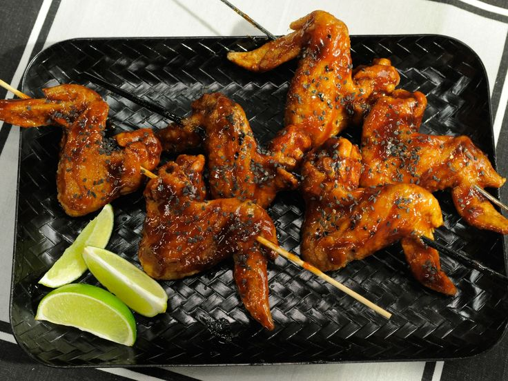 Sunny's Root Beer BBQ Wings : Not just for drinking, your favorite root beer soda serves as the base of Sunny Anderson's tangy, spicy barbecue sauce, which she heats up with the spice from a single ghost pepper.