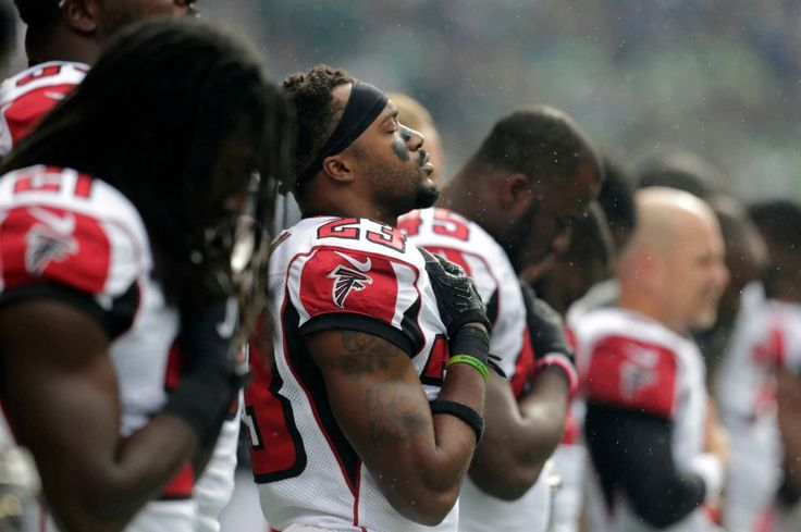 Falcons vs. Seahawks:    October 16, 2016  -  26-24, Seahawks  -    Atlanta Falcons players, including cornerback Robert Alford (23), stand during the singing of the national anthem before an NFL football game against the Seattle Seahawks, Sunday, Oct. 16, 2016, in Seattle.