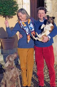 Marnie and Guy aka Comte and Comtesse de Vanssay with Diva, the Weimaraner, and Poum, the Fox Terrier. Their Château de La Barre, which has been in the family for over 600 years, is located in the Loire Valley on a 100-acre park, with gardens, a family chapel, and Sixteenth Century fortifications.