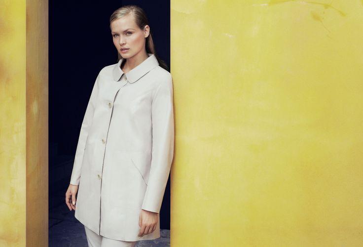 Marina Rinaldi SS14 heat-seamed pearl raincoatworn over coordinated trousers in techno-cotton and nylon.