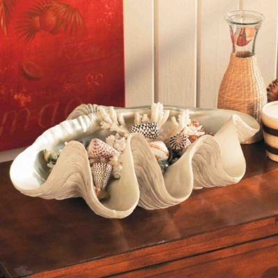 Real ones can grow up to 4 feet long and weigh 500 pounds! Our Giant Clam Shell is perfectly sized to add a tropical touch to your tabletop or bookcase. You can even use it to ice down beverages for outdoor parties. Giant Clam Shells are handcrafted of resin with pearlescent interior. $129.00 Ballarddesigns.com