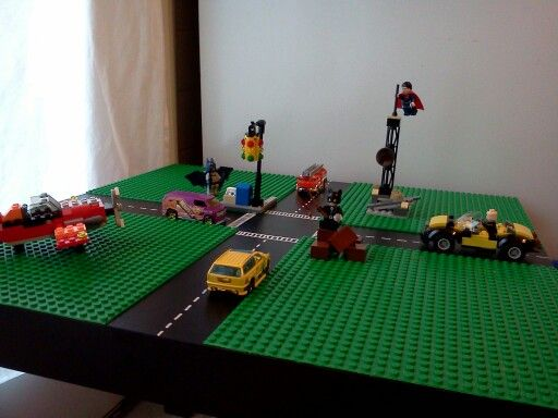 Lego/Hot Wheels table made from a black IKEA Lack table, Lego base plates, a jar of contact cement, and a white paint pen. Total cost <$35