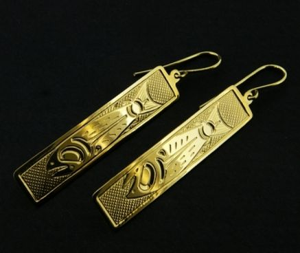 These elegant yet wearable Northwest Coast Native First Nations dangle earrings have been hand-engraved by Justin Rivard using solid 14 carat gold. They depict a 'Salmon' design. Salmon are viewed as symbols of the life cycle and renewal. $500. By Justin Rivard.