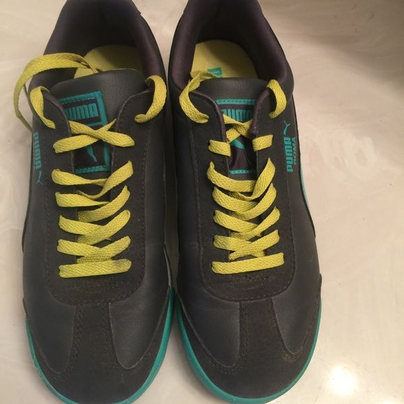 Puma tennis shoes Grey and turquoise puma tennis shoe. Boys size 5; however fits like a 6.5 women. Worn maybe twice, shoes are in perfect condition Puma Shoes Athletic Shoes