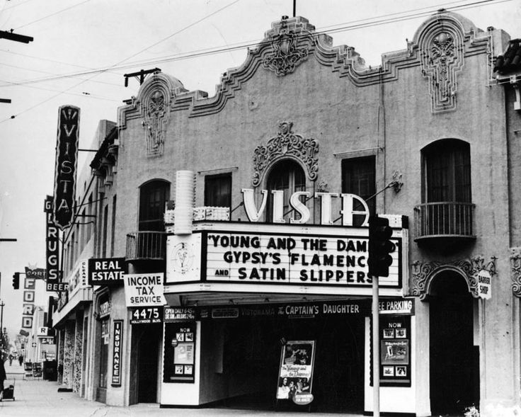 View Of The Front Of Egyptian Revival Style Vista Theater And Other Stores In The Row Down The Street Income Tax Service Historic Theater Los Angeles Theatre
