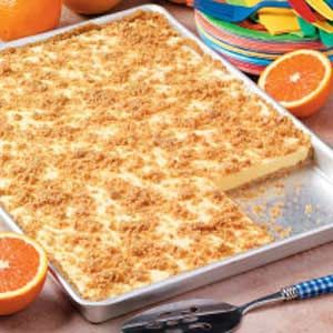 orange creamsicle dessert with graham cracker crust and topping.