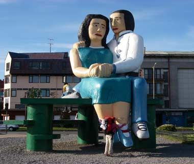 Two Lovers, Puerto Montt, Chile Looking out over the bay in Puerto Montt in southern Chile, you'll have two giant friends to keep you company. However, the morose lovers will probably be too caught up in their own emotions to pay attention to you. Maybe that's why over the years the enormous couple has been marred by graffiti. Or maybe it's just because the locals think the luridly colored statue is already an eyesore.