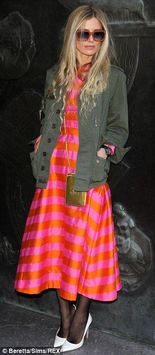 Laura Bailey in hot pink & orange striped dress with gold Chanel bag and white heels.