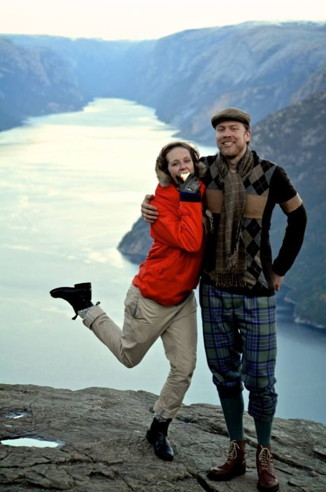 Ryan and Alette are at Preikestolen, Norway. Once again, Ryan is wearing a large lambswool scarf with a tweed cap from W Bill. And, although you can barely see it, under her coat, Alette is keeping the wind at bay with a cashmere tartan scarf from Scotland