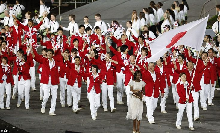 Japan's outfits matched the colour of their national flag and they were led out by Saori Yoshida, a weightlifter who has already won two Olympic gold medals