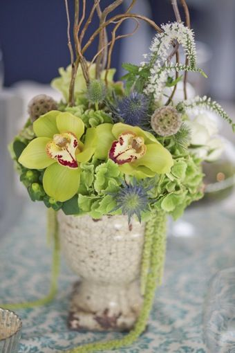 I love orchids & these are pretty for a beach wedding.  Green Cymbidium Orchids.