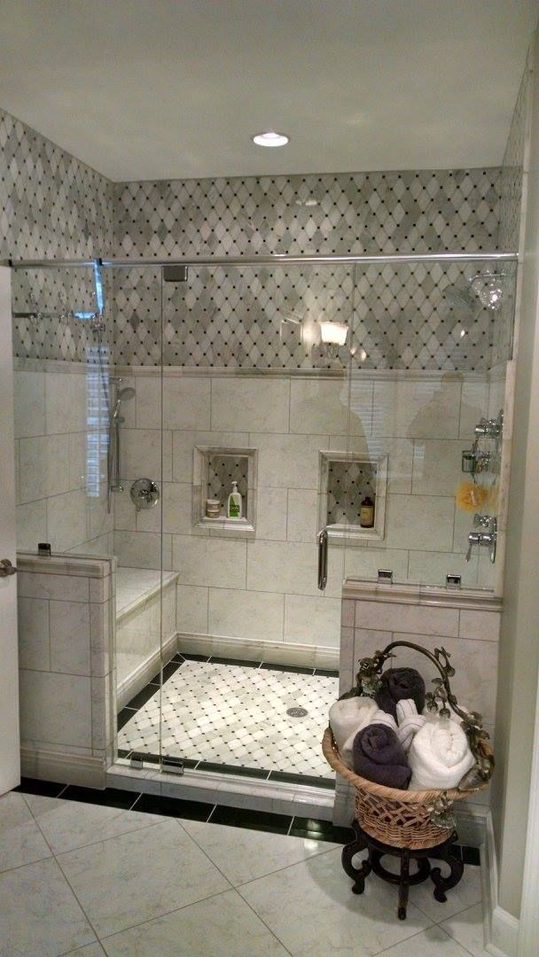 Beautiful shower with Carrara Marble tile wall and floor, bench seat, double shower head. Love the look and function. #BeautifulBAthrooms