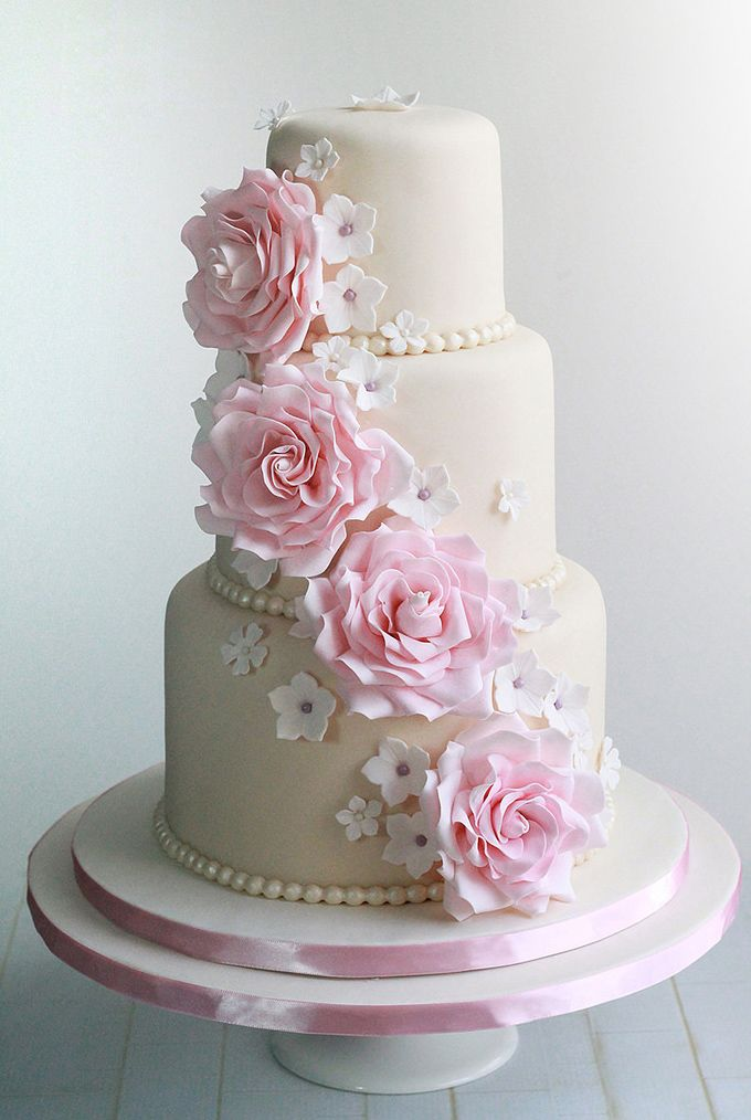 white wedding cake with pink roses. Baked with love by @sweetavenueca