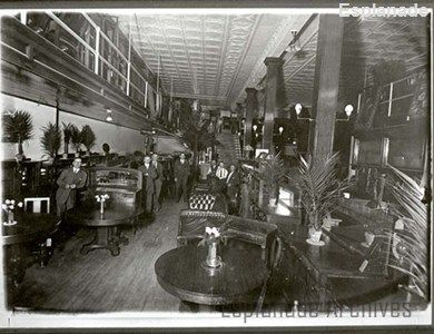 An interior view of the J.C. Beveridge Ltd. store in Medicine Hat, showing sales staff and customers in the elaborate furniture department on the main floor of the new building constructed in 1911