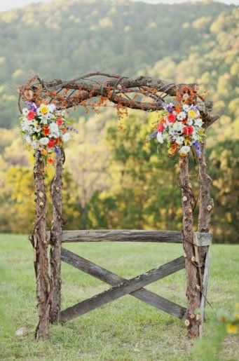 rustic altar flowers | Photo by Jodi Miller