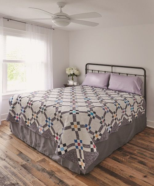 Classic Nine Patch quilt block that is fat quarter friendly creates this bed quilt by Rita Swain