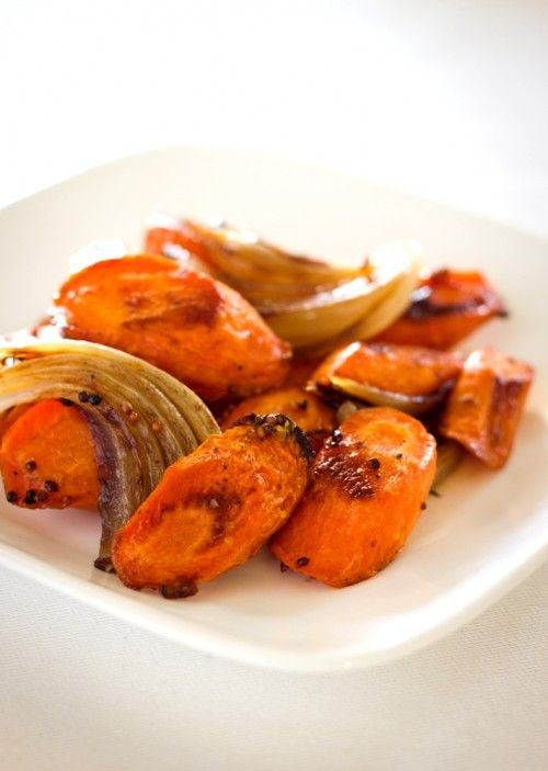 Caramelized Carrots and Onions with Whole Grain Mustard 1 tablespoon vegetable oil 2 tablespoons whole-grain mustard 1½ tablespoons packed light brown sugar ½ tablespoon cider vinegar 2 medium onion, cut into 1-inch wedges 7 medium carrots, cut 1-inch thick on the diagonal 1 tablespoon butter Salt and pepper to taste