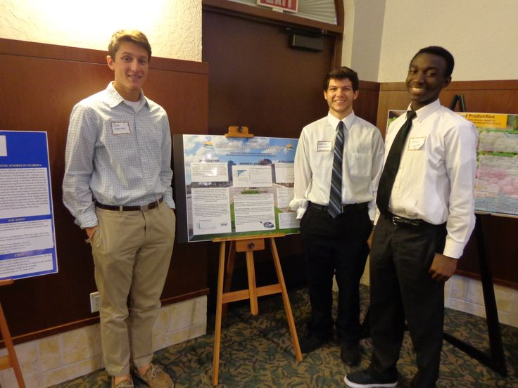 Suncoast Polytechnical High school Sustainable Transportation poster team Xavier Griffin, Owen Homeister and Lennon Spoonmore at the Sarasota Sister Cities International Sustainability & Aquaculture Conference at the University of South Florida Sarasota-Manatee in November 2013