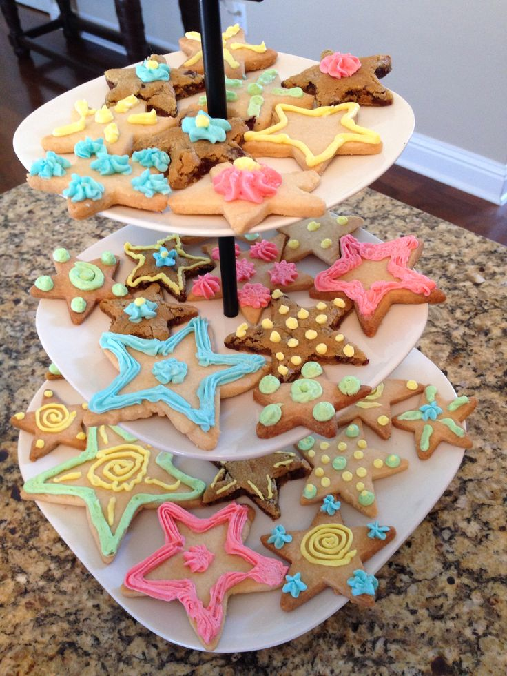"""Star cookies for """"twinkle twinkle little star how we wonder what you are"""" theme gender reveal."""