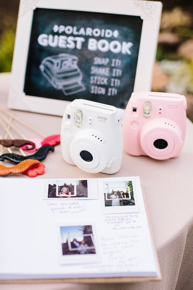 Polaroid book with cameras for guest book memories.  - Melissa Jill Photography