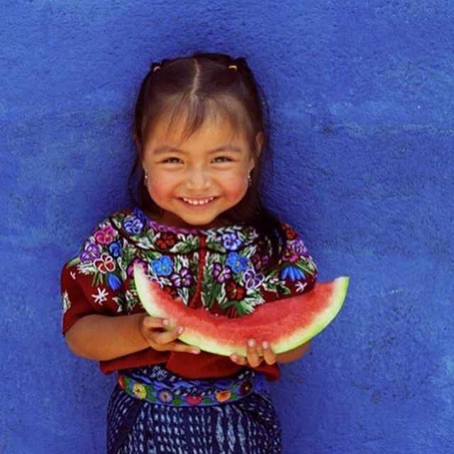 girl with a cute smile enjoying a watermelon