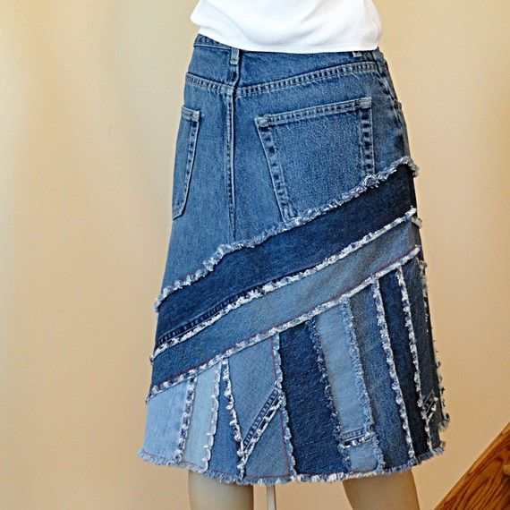 Reworked from previously loved blue jeans, this great pieced denim skirt features a diagonal cut yoke that is wonderfully figure flattering. Cut is a slightly flared a-line. Lower blue jeans skirt has diagonal and vertical strip piecing to compliment the yoke. Strips are cut from plain and character parts from several pairs of blue jeans. Red stitching throughout adds a visual pop. - This listing is for a custom upcycled jean skirt in the pictured style - Made to order in your personal…