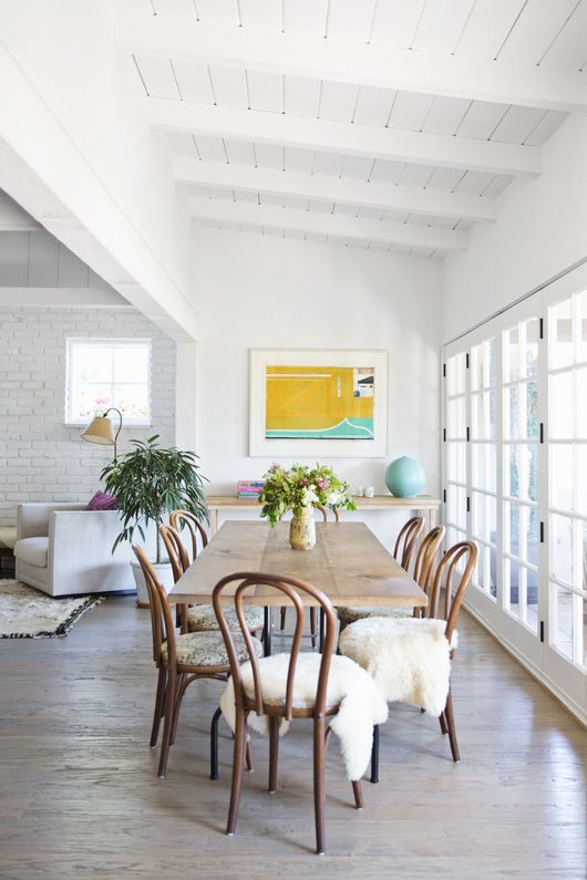 In The Dining Space A Set Of Bentwood Chairs Surrounds Table Made Locally Salvaged Pinewood Home Decor And Interior Decorating Ideas
