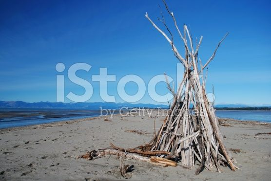 Driftwood Cairn, Motueka Spit, Tasman, NZ royalty-free stock photo