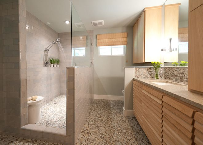 Glass on top half only in a large, walk-in shower.  contemporary bathroom by Schroeder