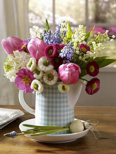 the ceramic pitcher is adorable and the bright spring flowers are the perfect addition.