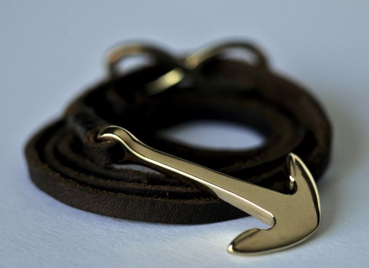 The Statherós: A gold stainless steel anchor with a matching infinity charm, bound with 4mm brown genuine leather lace that adjusts to any wrist. (Statherós- Greek for Steadfast)