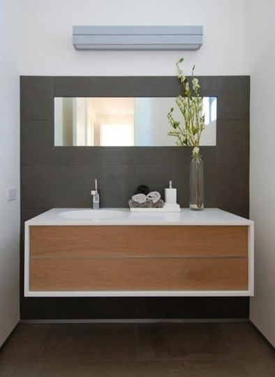 Love the minimalism, the big, dark tile on the wall, and the floating cabinet.