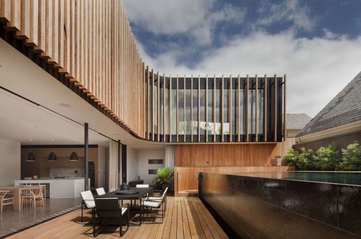 Architecture, Entrancing Kooyong Residence Located In Melbourne By Matt Gibson Architecture Featuring Wood Paneled Exterior Wall Deck Dining Table Kitchen With Swimming Pool: Stunning Curved House Designs with Wood Elements