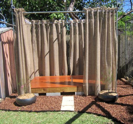 Backyard Stage. Add some stringed white lights and outdoor bean bags for the audience