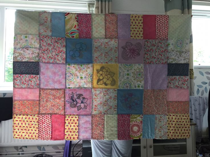 Hand made quilt with hand embroidered flowers.