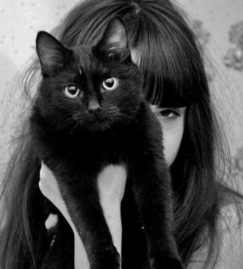 Girl with pet black cat.  (omg, so cute!)
